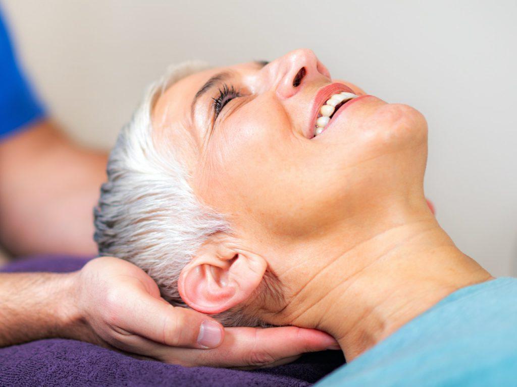 Senior Woman Visiting Physical Therapist