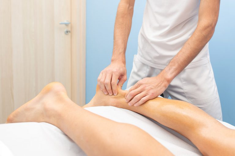Physiotherapist during an Achilles tendon treatment.